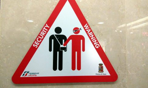 Pickpocket warning sign, train station, Turin, Italy